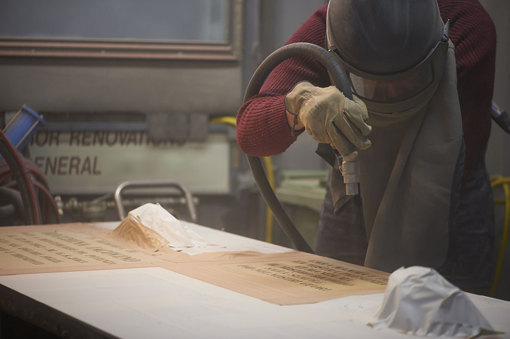 Sandblasting the inscription